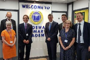 Education Secretary Gavin Williamson fourth from left, and Harboroug MP Neil O'Brien on the right