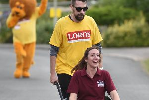 Hollie Jaffer of Home Instead gets help from a Loros supporter. PICTURE: ANDREW CARPENTER
