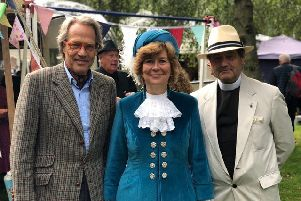 The High Sheriff of West Sussex Mrs Davina Irwin-Clark is pictured with the Duke of Richmond and her husband and chaplain, Peter, at this year's Goodwood Revival supporting Care for Veterans, the event's chosen charity