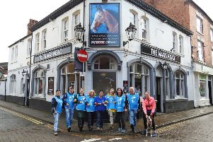 Stepping out...centre, Carole Tilley with friends set off from the Nags Head pub in Market Harborough during their annual sponsored walk this year for Guide Dogs.'PICTURE: KATIE MACKENZIE