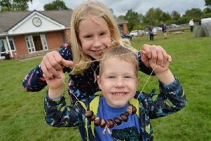 Conker fun...Matilda Baker 9 and brother Noah 4 during the annual conker championships in Husbands Bosworth.