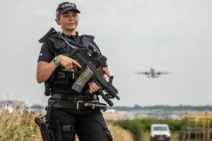 Armed police at Gatwick Airport last month