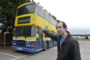 Christopher Bedford with the Big Bus for the homeless (Photo by Jon Rigby) SUS-190114-121644008