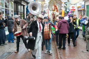 Hastings Fat Tuesday: Umbrella Parade. Photo by Frank Copper. SUS-190402-115049001