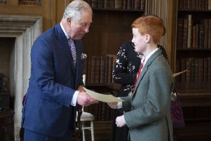 Prince Charles presents certificate to -'Edward Thomson /