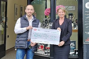 Sophie Cullen, owner of L. Guess Jewellers, presents the cheque to Freestyle 4 Smiles founder Nathan Abbott