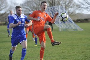 Action from the top-of-the-table clash between Sidley United and Battle Baptists. Pictures by Simon Newstead