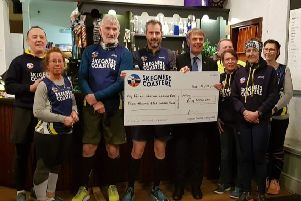 The Coasters hand �4,500 to the local branch of the Royal British Legion. Ygr4tfeSeLnTx85BSnnd