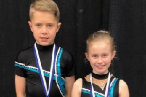 Liam Webb and Jolie Nash with their bronze medals