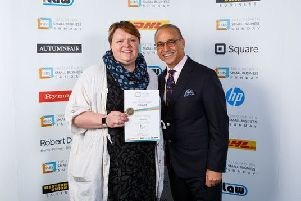 Jo Slesser receives the Small Business Sunday award from Dragon's Den entrepreneur Theo Paphitis.