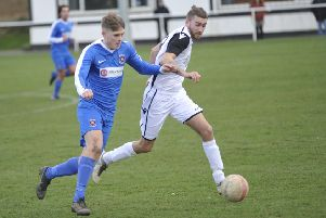 Nathan Lopez wins possession during Bexhill United's most recent league game, at home to Oakwood on Saturday March 9. Picture by Simon Newstead