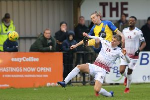 Jack Tucker slides in to a tackle during Hastings United's 5-0 win at home to Sittingbourne in January. Picture courtesy Scott White