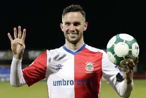 Linfield's Andrew Waterworth celebrates his four goals