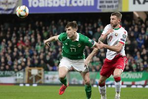 Northern Ireland's Paddy McNair and Belarus's Mikhail Sivakow.  Photo by David Maginnis/Pacemaker Press