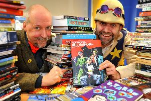 Steampunk hip hop entertainer Professor Elemental, right, presents more than 100 graphic novels to senior library assistant Dan Belton at Southwick Library. Picture: Steve Robards SR1908334