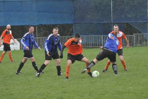 Action from The JC Tackleway's third round victory away to Hollington United II in December. Picture by Simon Newstead