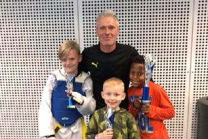 Joshua, Danila and Ben are pictured with coach Jason.