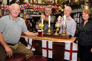 Queens Head Pub, Icklesham. Beer Festival.'02.10.10.'Picture by: TONY COOMBES PHOTOGRAPHY.'Customer David Martyn with bar staff Rob May, Ian Mitchell and Sally Warren.'BH41702b