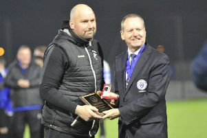 Hollington United manager Scott Price receives his awards after last night's final. Picture by Simon Newstead