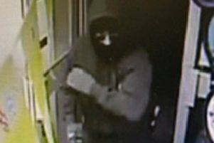 A CCTV image of the armed raider at the One Stop store in Boston.