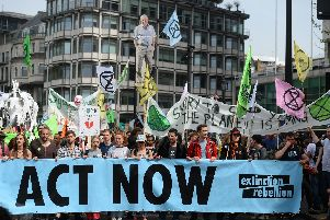 Extinction Rebellion protesters march from their camp in Marble Arch down Park Lane in London.