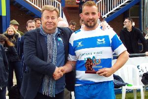 Hastings & Bexhill Rugby Club captain Joe Umpleby receives the Bob Rogers Sussex Cup runners-up trophy from Simon Dixon, south coast area manager of Harvey's Brewery. Picture courtesy Peter Knight