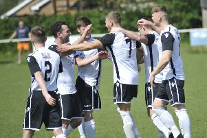 Bexhill United celebrate scoring during their Easter Monday victory away to Hailsham Town