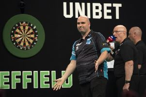 Rob Cross celebrates after completing his 8-4 win over Mensur Suljovic. Picture courtesy Lawrence Lustig/PDC