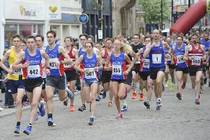 Runners set off at the start of the 2018 Hastings Runners Five-Mile Race. Picture by Simon Newstead