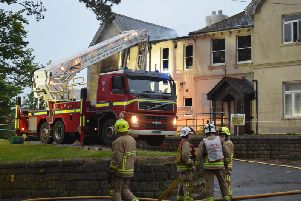 Firefighters tackle the flames