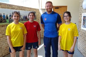 England cricket star Jonny Bairstow with pupils at Vinehall School