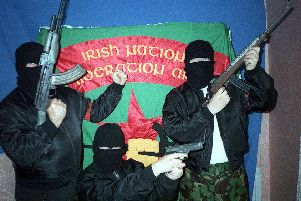An INLA show of strength in West Belfast in 2004. Photo: Pacemaker.