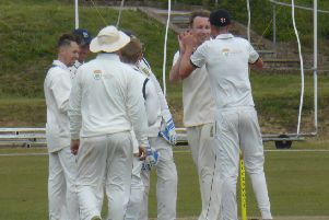 Hastings Priory Cricket Club celebrates its third wicket against Burgess Hill. Picture by Simon Newstead