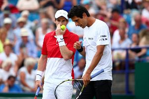 EASTBOURNE, ENGLAND - JUNE 25: Andy Murray of Great Britain and Marcelo Melo of Brazil in action during their mens doubles match against Columbian pair Juan Sebastian Cabal and Robert Farah during day two of the Nature Valley International at Devonshire Park on June 25, 2019 in Eastbourne, United Kingdom. (Photo by Charlie Crowhurst/Getty Images for LTA) SUS-190625-220810002