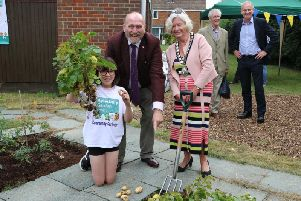 Grace Tomkinson with Cllr. Bill Chapple OBE Chair of Aylesbury Garden Town digging the first potatoes