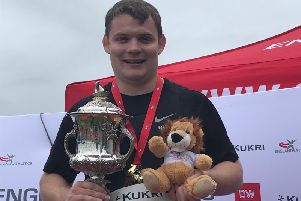 Rugby hammer thrower Craig Murch with his gold medal, trophy and Lion after his victory in Manchester