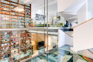 The floor to ceiling bookcase