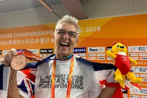 Sally Mills is all smiles with her World Masters Championships bronze medal