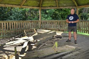 Ed Croft, the schools business manager, pictured alongside the damage
