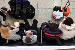 Travellers queue at Gatwick Airport earlier this year. Pic: BEN STANSALL/AFP/Getty Images