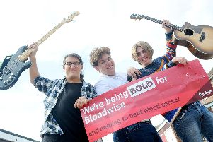 Milo Baker (middle), 17, is organising a music charity event on Saturday 14th September at Waverley Bowls Club to raise money for the cancer charity, Bloodwise, after his uncle, Gary George, died at just 44.  Picture: Sarah Standing (050919-4982)