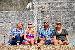 A group of friends relax in the sun at the Hot Walls in Southsea, Portsmouth. Picture: Solent News & Photo Agency