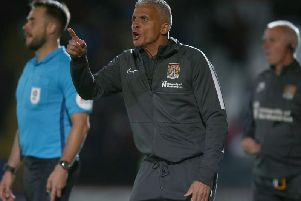 Keith Curle gets his point across during the Cobblers' 1-0 win at Stevenage (Picture: Pete Norton)