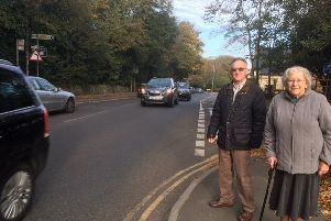 Cllr Martin Clarke with a resident calling for a crossing at The Ridge.