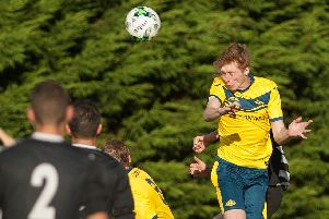 Liam Kyle, right, in action for Moneyfields in 2016