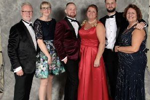 Tracey Walker and Chris Walker with their sons Tom and Charlie, together with Vera Papaspyrou and Laura Smith, from Counselling Plus SUS-191119-112352001