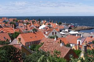 The picturesque red-tiled roofs of Gudhjem is home to Denmark's annual 'Sol Over Gudhjem' cookery competition and its week long food festival.