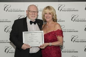 Mark Bannister with his award from The Guild of Photographers.