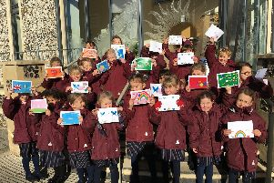 The children of Portsmouth High School with their positive postcards.