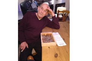 Ross Morgan, 75, with his box ready to be sealed